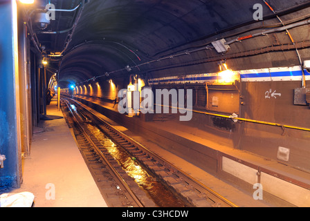 Looking down a Subway tunnel below New York City. - Stock Photo