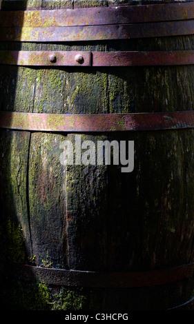 Old weathered traditional oak barrel - Stock Photo