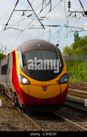 Tilting Virgin Voyager approaching Preston Railway Station, Lancashire, UK - Stock Photo