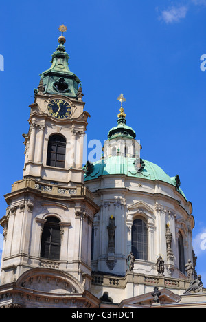 Steeple and clock tower of St. Nicholas Cathedral in Prague, Czech Republic. - Stock Photo