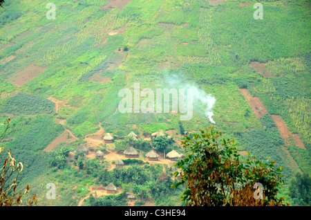 African huts and farmlands in highlands of eastern Democratic Republic of Congo in January 2011. - Stock Photo