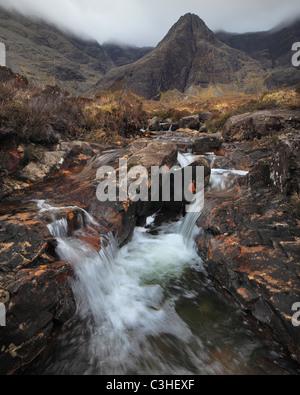 Fairy Pools along Alt Coir a Mhadaidh below Sgurr an Fheadaih in Glen Brittle on the Isle of Skye in Scotland - Stock Photo