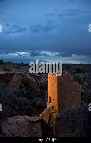 Ancestral Puebloan Holly Tower sits on tall, narrow boulder at dusk in Hovenweep National Monument in southern Utah, - Stock Photo
