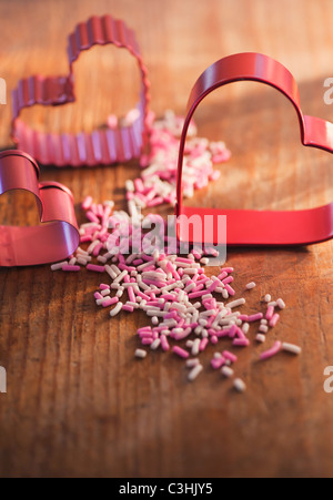 Studio shot of heart-shaped pastry cutters - Stock Photo