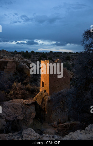 The Holly Tower sits on tall, narrow boulder at dusk at Hovenweep National Monument in southern Utah, USA. - Stock Photo