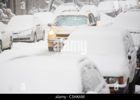 USA, New York City, street with cars covered with snow - Stock Photo
