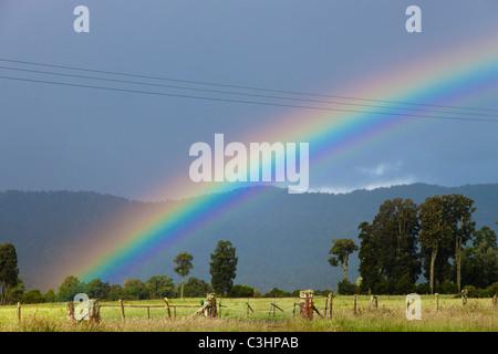 Rainbow, rural landscape, Fox Glacier, West Coast, New Zealand - Stock Photo