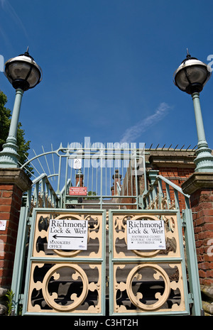 closed gate with signs at richmond lock and weir on the river thames between richmond and st margarets - Stock Photo