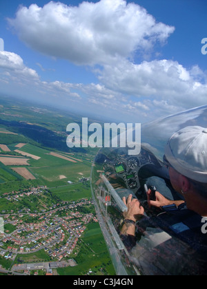 Glider plane cockpit view over Sarreguemines town and airfield, Lorraine, France.  Glider model's Duo-Discus. - Stock Photo