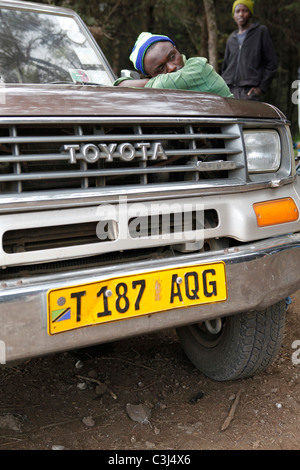 yellow licence plate on a Toyota Landcruiser in Tanzania. - Stock Photo