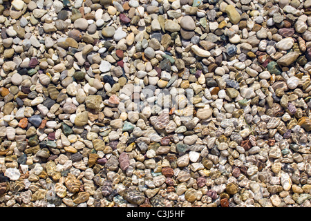 Pebbles under the water on beach - Stock Photo