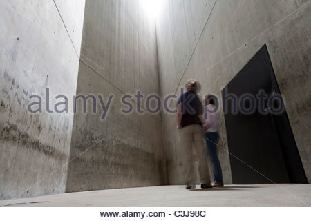 Tourists in the 'Holocaust Tower' at the Jewish Museum in Berlin, designed by architect Daniel Libeskind. Berlin, - Stock Photo