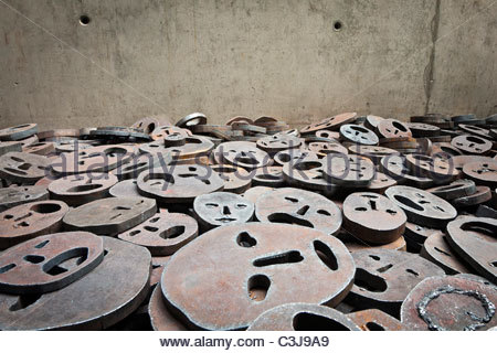 Detail of metal faces from Shalekhet (Fallen Leaves) by Menashe Kadishman in 'The Void' at the Jewish Museum, Berlin, - Stock Photo