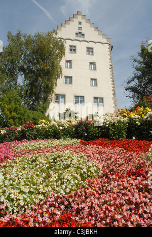 Flower beds in front of the Bischofsburg, now a hotel, in Markdorf, Upper Swabia, near Lake Constance in Baden-Württemberg - Stock Photo