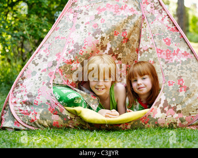 Two children in a tent - Stock Photo