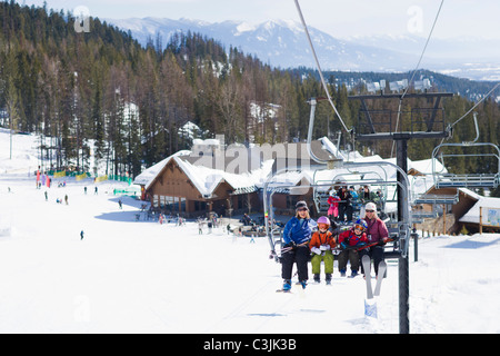 Family on ski lift - Stock Photo