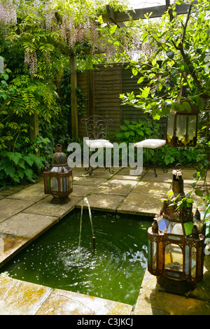 Small garden pond in an english country garden stock photo for English garden pool