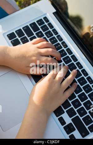 Girls using laptop - Stock Photo