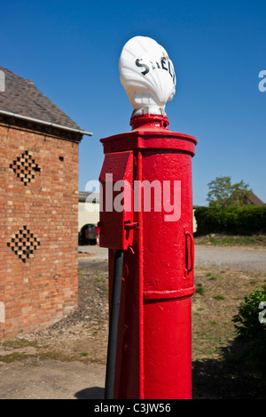 Old fashioned red Shell petrol pump - Stock Photo