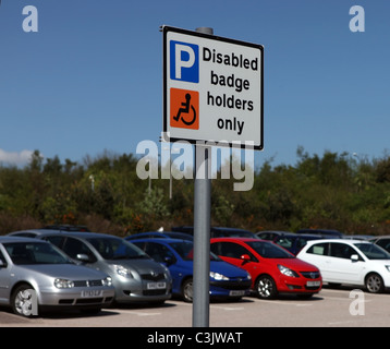 Disabled badge holders only sign for disabled drivers in a car park in the uk. - Stock Photo