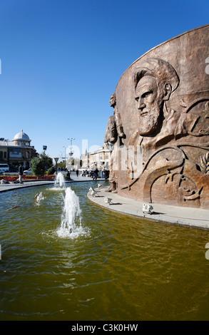 Monument to the Iran Iraq War depicting Ayatollah Khomeini in Hamadan, Iran - Stock Photo