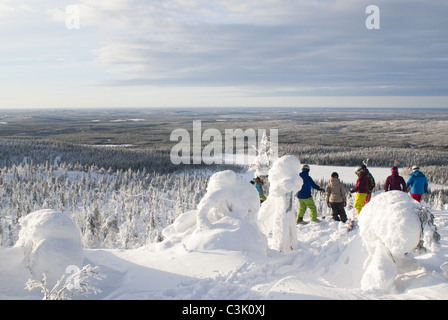 A group of free-skiers admiring the view in Isosyöte, Finland - Stock Photo