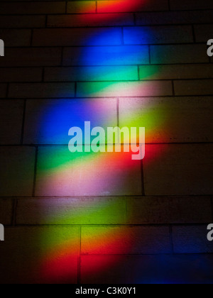 Sunlight refracted through a window forms a spectrum on a wall in Washington, D.C. - Stock Photo