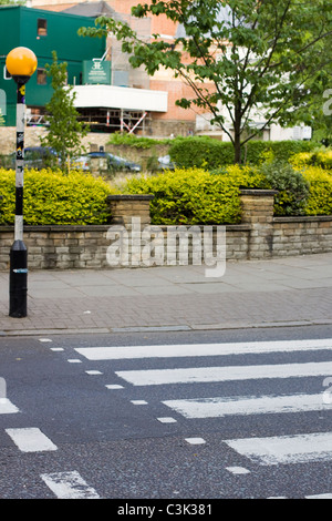The Famous Abbey Road Zebra Crossing on Abbey Road London UK - Stock Photo