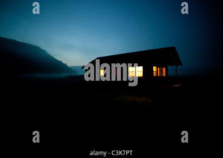 house light on at night - Stock Photo