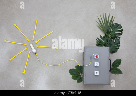 Lightbulb connected to electric sockets with leaves - Stock Photo