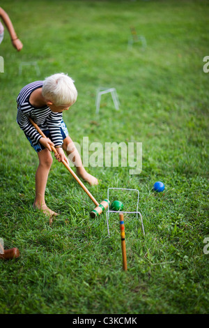 Boy playing croquet - Stock Photo