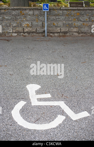 Disabled sign on parking - Stock Photo