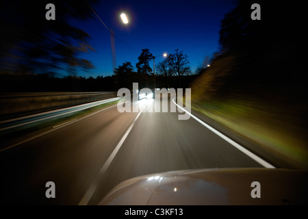 View of road from car at night - Stock Photo