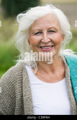 Portrait of senior woman smiling - Stock Photo
