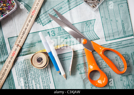 Sewing patter, scissors and tape measure, still life - Stock Photo