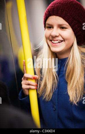 Teenage girl (14-15) in underground train Stock Photo