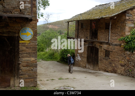 Pilgrim walking along the route of the Camino de Santiago, Northern Spain - Stock Photo