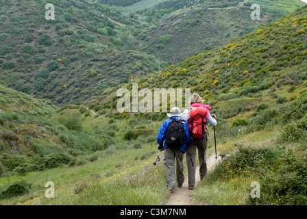 Pilgrims walking along a footpath in the Camino de Santiago, Northern Spain - Stock Photo