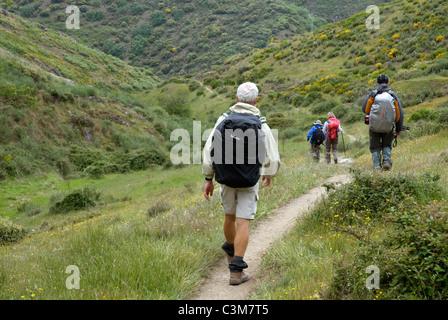 Pilgrims walking along a footpath in the Camino de Santiago, Northern Spain - Stock Photo