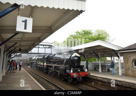 Double headed steam locomotives 'Black Five' 45305 and 'Brittania' 70013 'Oliver Cromwell' speed through St.Erth - Stock Photo