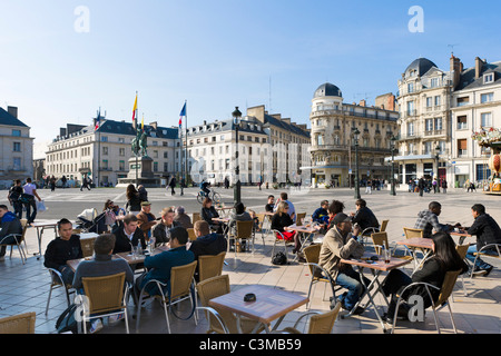 Pavement cafe in front of the statue of Joan of Arc, Place du Martroi, Orleans, France - Stock Photo