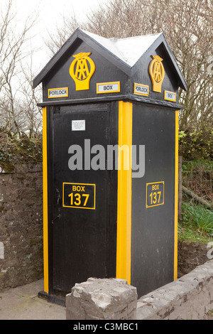 Traditional AA Automobile Association emergency telephone box on Exmoor at the top of Porlock Hill, Porlock, Somerset - Stock Photo