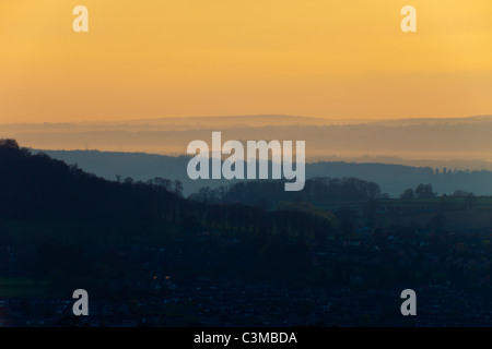 Dusk falling on Oldbury nuclear power station viewed from the Cotswolds across the intervening town of Dursley, - Stock Photo