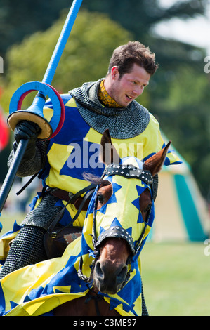 A Knight jousting at Blenheim palace, Oxfordshire, England. - Stock Photo