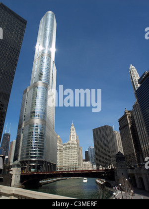 view of the Trump Tower and the Wrigley Building from the State Street Bridge at the Chicago River, Chicago, IL - Stock Photo