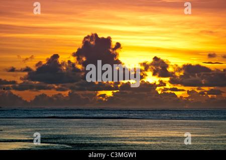 Fijian sunset off the Coral Coast from the island of Viti Levu, Fiji - Stock Photo