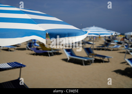 Itlay, Adria, Rimini, Sunshades and chairs on beach - Stock Photo