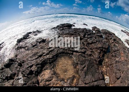 sea water crashing over rocks Fuerteventura Canary Islands - Stock Photo