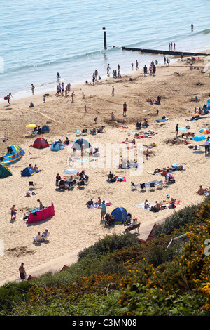 Looking down over Bournemouth beach on a crowded Easter Bank Holiday weekend in April - Stock Photo