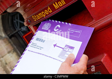 Man posting 2011 census form England UK United Kingdom GB Great Britain - Stock Photo